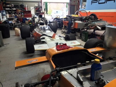 Two Mclaren historic Formula 1 cars, one an M14 and the other an M19.